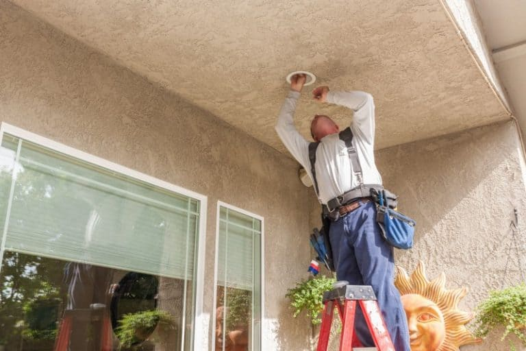 electrician working on recessed lighting
