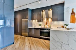 remodeled kitchen with track lighting and marble counter tops