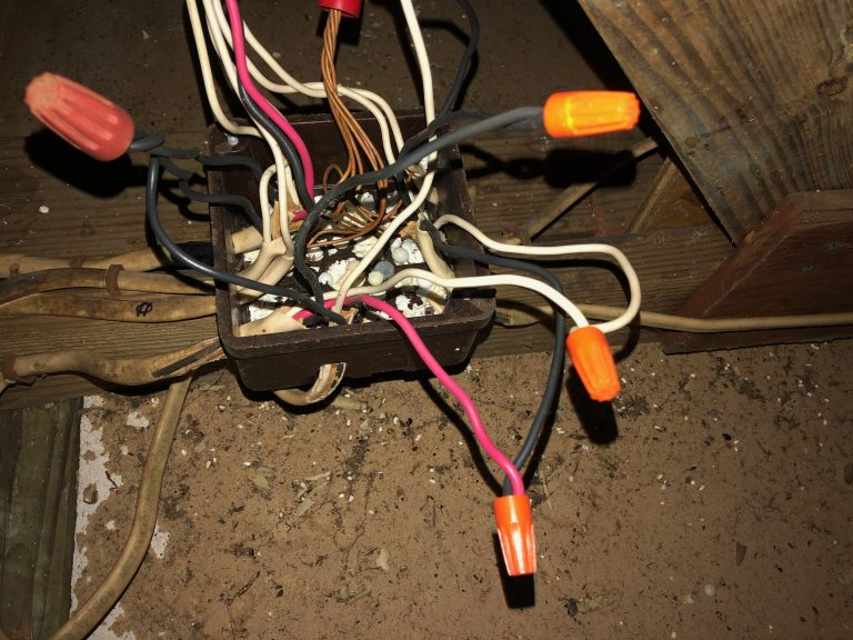 filled electrical junction box in attic