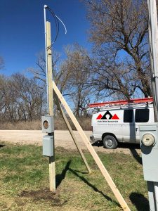 temporary power pole with utility van