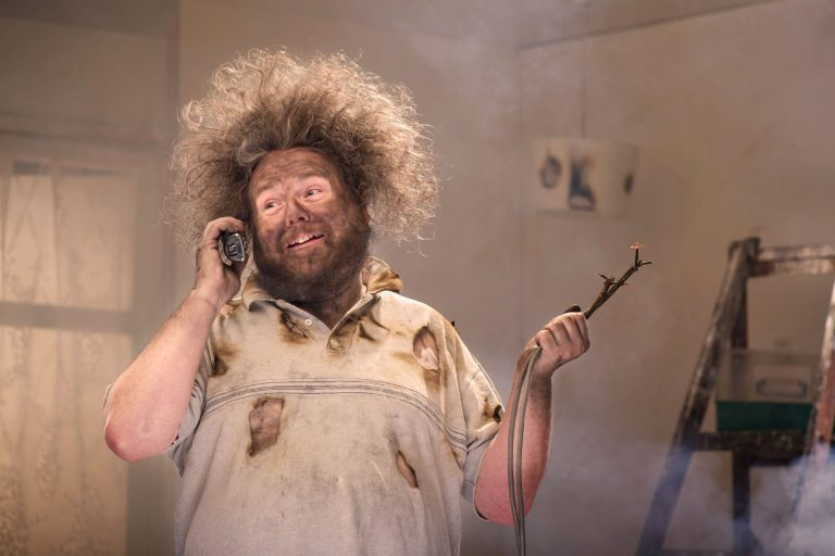 man on phone with burnt house funny