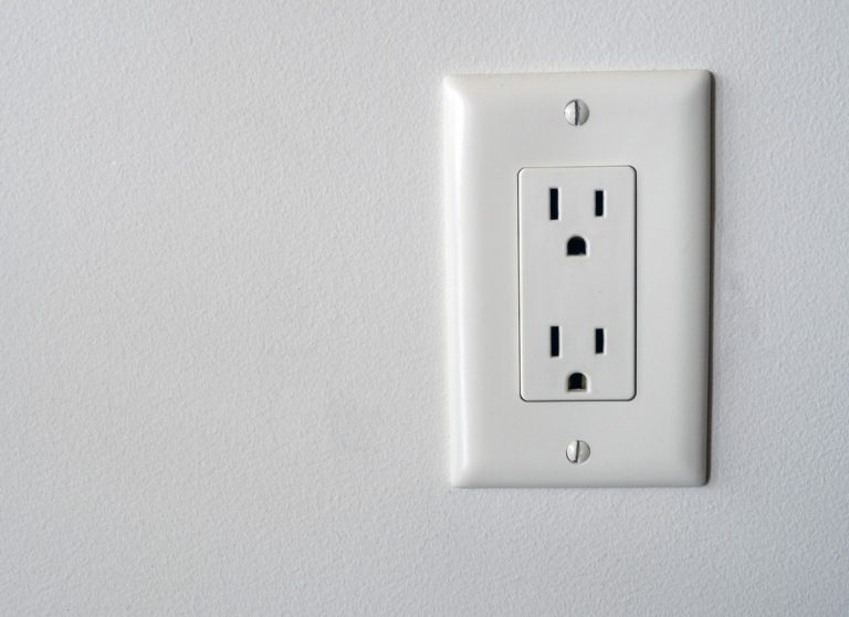 Outlet on bare wall